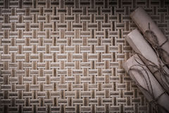 Vintage rolls of paper on wicker wooden background Royalty Free Stock Photography