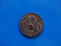 Vintage Roman coin over blue Stock Images