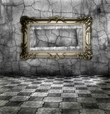 Vintage room. Carved gilded frame on silver wall Royalty Free Stock Image