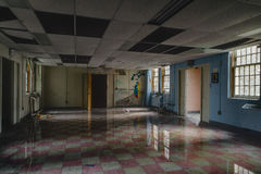 Vintage Room with Flood Water and Reflection - Abandoned Hospital / Sanitarium - New York. An interior view of a flooded room with reflection inside an abandoned stock image