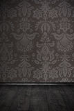 Vintage room with floral wallpaper and wooden floor. Vintage room with floral wallpaper and dark wooden floor stock images