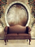Ornamented window and vintage sofa Royalty Free Stock Photo