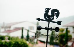 Vintage Rooster weather vane weathercock silhouette, weathe. Metal Vintage Rooster weather vane weathercock silhouette, weather vane stock photo