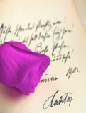 Vintage rose. Purple rose on vintage letter in German royalty free stock photography