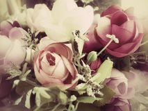 Vintage rose of artificial flowers Stock Images