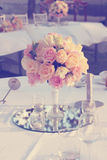 Vintage rose flower arrangement for wedding table Stock Photo
