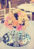 Vintage rose flower arrangement for wedding table Stock Images