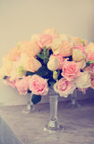 Vintage rose flower arrangement for wedding table Stock Photography