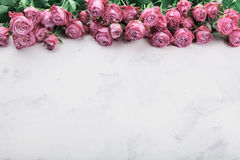 Vintage rose flowers on white stone table. Floral border. Empty space for text. Vintage rose flowers on white stone table. Floral border. Copy space for text Royalty Free Stock Images