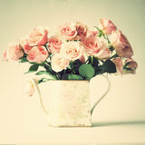 Vintage roses in a jar Stock Photography