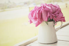 Vintage roses with vase Stock Photography