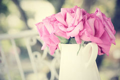 Vintage roses with vase Royalty Free Stock Photos
