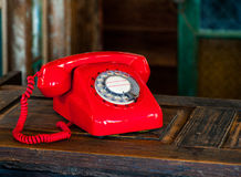 Vintage rotary red telephone Stock Photography