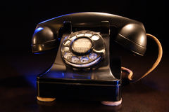 Vintage Rotary Telephone. A stock photograph of a vintage black rotary telephone from the 1940's era Stock Images