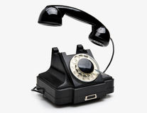 Vintage rotary telephone. Old black vintage rotary style telephone isolated over a white background Stock Photo
