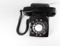 Vintage Rotary Telephone. Black vintage rotary telephone on white from above Stock Photography