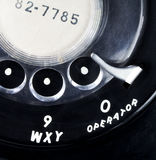 Vintage Rotary Telephone Close-up. Close up of a vintage black rotary telephone dial with `operator Stock Image