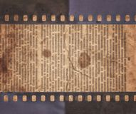 Vintage background with old newspaper and retro film strip. Vintage rough background with old newspaper and retro film strip Stock Photography