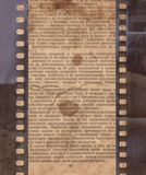 Vintage background with old newspaper and retro film strip. Vintage rough background with old newspaper and retro film strip Royalty Free Stock Photo