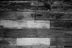 Vintage rough old wooden panel in black and white tone texture background. Royalty Free Stock Image