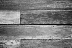 Vintage rough old wooden panel in black and white tone texture background. Royalty Free Stock Photo