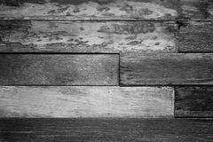 Vintage rough old wooden panel in black and white tone texture background. Stock Photo