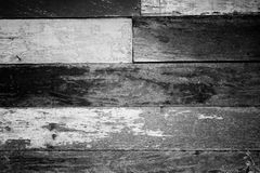 Vintage rough old wooden panel in black and white tone texture background. Royalty Free Stock Photography