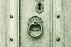 Vintage Round Door Knocker on a Door. Shallow Depth of Field horizontal black and white split toning photography stock photos