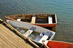 Vintage Row Boats Secured to Dock Stock Photos