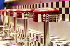 Vintage Row of metal bar stools, interior, red metal chairs near royalty free stock photo