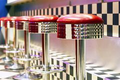 Vintage Row of metal bar stools, interior, red metal chairs near stock images