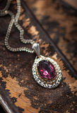 Vintage ruby pendant with chains Stock Photos