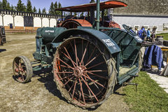 Vintage running farm vehicle. Vintage running red and black farm vehicle stock photo