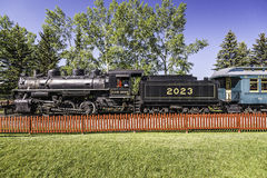 Vintage running train. Vintage running black steam locomotive with carriages royalty free stock images