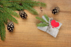 Vintage rural gift  and Christmas tree branch Royalty Free Stock Image