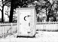 Vintage Rural Outhouse in Black in White in Winter Stock Images