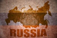 Vintage russia map. Russia map on a vintage russian flag background stock image