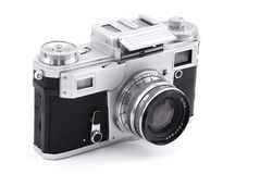 Vintage Russian analog photo camera. Vintage Russian analog camera isolated on white Stock Images