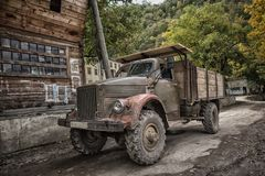 Vintage russian car truck in the mountains village Royalty Free Stock Images