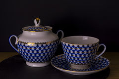 Vintage Russian porcelain teacup and sugar-bowl, isolated black background, Russian style cup Royalty Free Stock Image