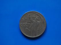 Vintage Russian ruble coin over blue Stock Image