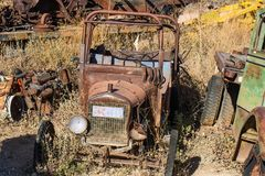 Vintage Rusted Car In Salvage Yard royalty free stock photos