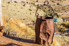Rusted Ore Bucket Used In Mining Operations. Vintage Rusted & Dented Ore Bucket Once Used In Mining Operations Stock Photography