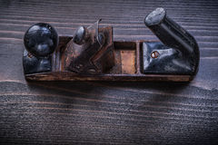 Vintage rusted planer on wooden board construction. Concept Royalty Free Stock Photos