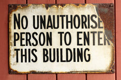 Vintage rusted poster. Vintage rusted No unauthorised person to enter this building poster sign royalty free stock photo