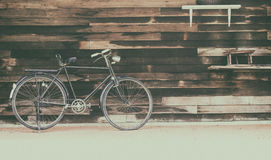 Vintage rusted racing bicycle parked in an old factory with wood Royalty Free Stock Photo