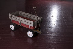 Vintage Rusted Red Metal Utility Wagon on Old Wood Floor Stock Images
