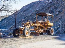 Vintage Rusted Road Grader royalty free stock images