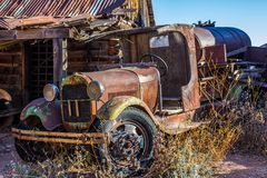 Vintage Rusted Tanker Truck In Junk Yard. Vintage Rusted Water Tanker Truck With Fenders & Running Boards In Salvage Yard Stock Photo