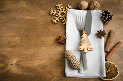 Vintage or rustic christmas table setting from above. Cutlery on napkin on rustic wooden background - country style. Vintage or rustic christmas table setting Stock Photos